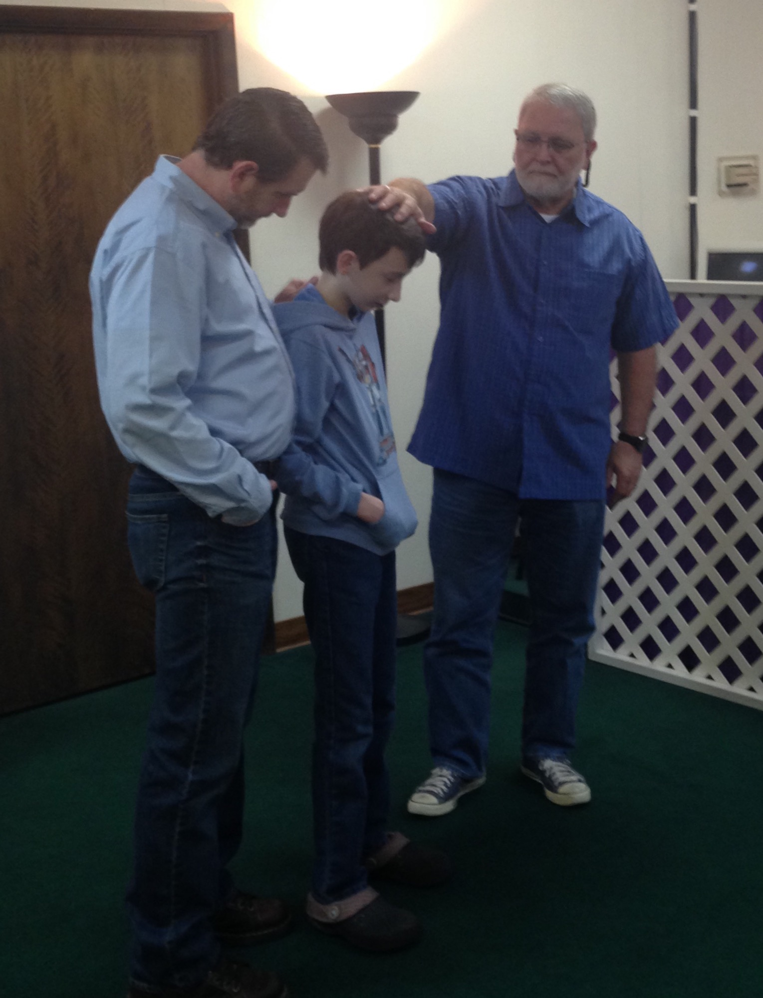 dad-praying-over-caleb